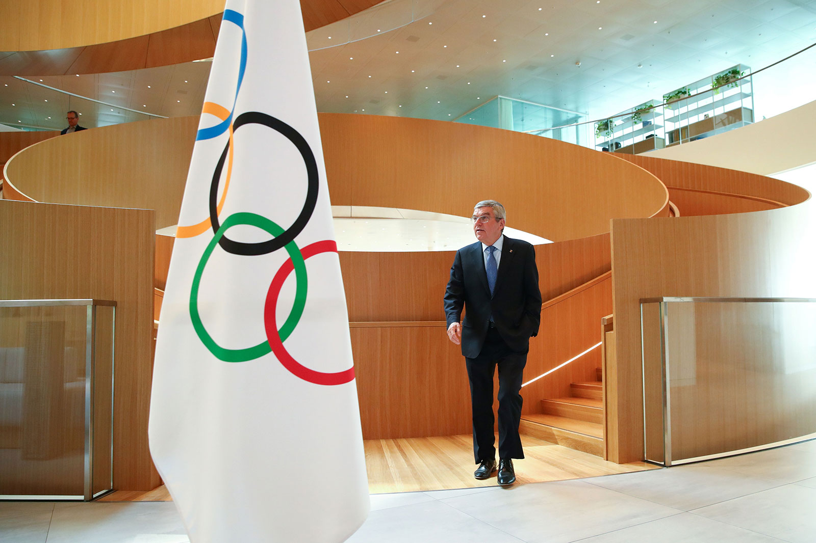 """International Olympic Committee (IOC) President Thomas Bach arrives for an interview after the historic decision to postpone the 2020 Tokyo Olympic Games due to the coronavirus pandemic, in Lausanne, Switzerland, on March 25, 2020. - Olympic chief Bach says """"all options are on the table"""" over finding a new date to hold the postponed Tokyo Games. Tokyo 2020 became the first Olympics in peacetime to be postponed due to the coronavirus pandemic. Announcing the unprecedented decision on March 24, the International Olympic Committee gave no specific new date, saying only it would be """"beyond 2020 but not later than summer 2021"""". (Photo by Denis Balibouse / POOL / AFP) (Photo by DENIS BALIBOUSE/POOL/AFP via Getty Images)"""