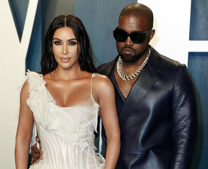 epa08208656 Kim Kardashian and husband, US rapper Kanye West (R), attend the 2020 Vanity Fair Oscar Party following the 92nd annual Academy Awards ceremony, in Beverly Hills, California, USA, 09 February 2020. The Oscars were presented for outstanding individual or collective efforts in filmmaking in 24 categories.  EPA/RINGO CHIU
