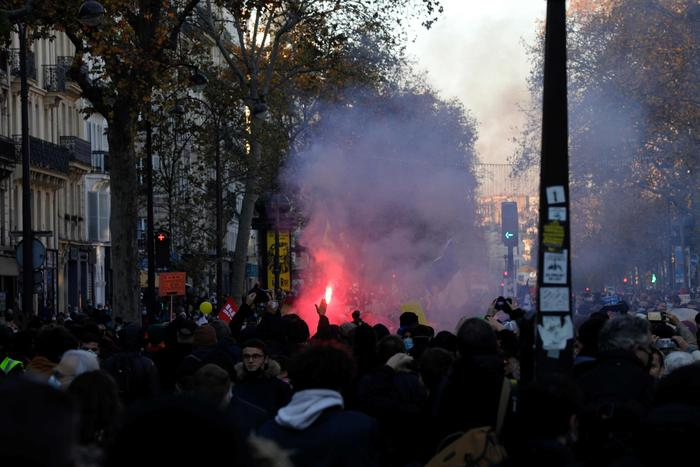"""Demonstrators rally near the Place de la Republique in Paris on November 28, 2020 during a protest against the """"global security"""" draft law, which Article 24 would criminalise the publication of images of on-duty police officers with the intent of harming their """"physical or psychological integrity"""". - Dozens of rallies are planned on November 28 against a new French law that would restrict sharing images of police, only days after the country was shaken by footage showing officers beating and racially abusing a black man. (Photo by GEOFFROY VAN DER HASSELT / AFP)"""